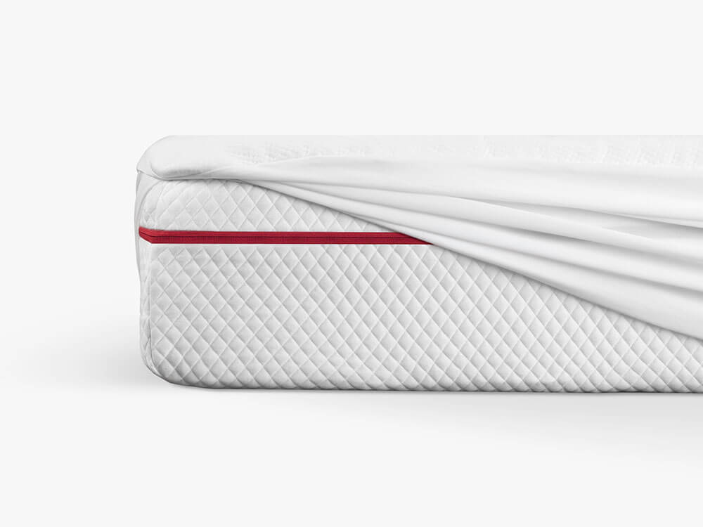 Mattress protector stretching over king-size Douglas.